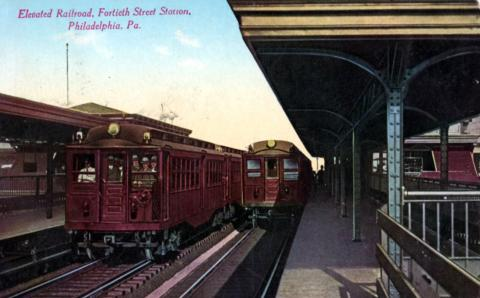 Two trains at elevated railroad station