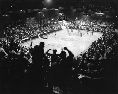Excited spectators pack the stands of the Arena at a 1966 76ers and Celtics game.