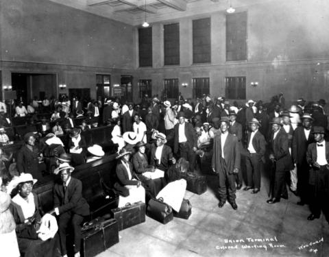 A segregated waiting room crowded with travelers at the Jacksonville railroad depot.