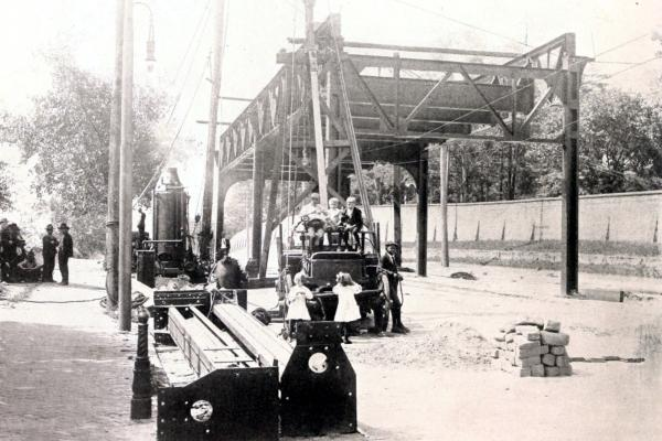 Children pose next to construction equipment near the first constructed section of the Market Elevated.